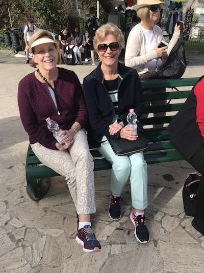 Resting on a bench Just Ladies Traveling